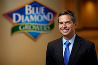 Business Headshot of Mark Jenson, Executive at Blue Diamond Growers. He is relaxed and smiling at the camera.