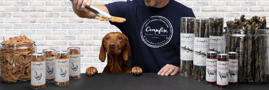 Product photography from GMP Sacramento of Campfire Treats merchandise on a counter top with their dog.