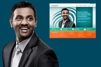 An executive portrait of a man smiling widely looking up and off in a suit . There is another image of the man on Cambria's website showing how the portrait was used by the client