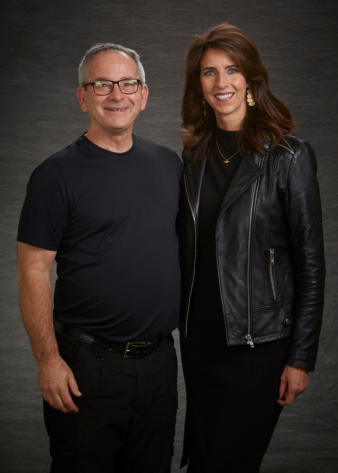 Gerry Mcintyre posing with Carey Lohrenz at the Sacramento Civic Center for the Prospectives on Leadership event in Sacramento put on the by the Sacramento Metro Chamber of Commerce