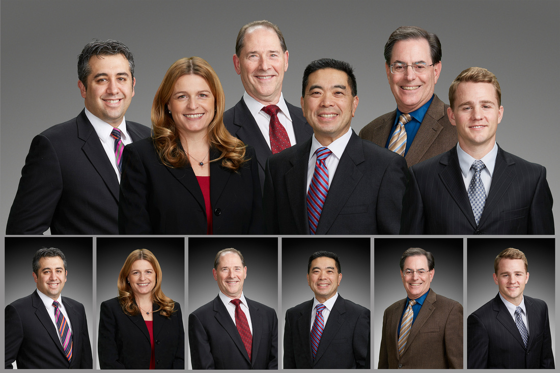 Medical Vision Technology executives posed together smiling at the camera in suits and ties.