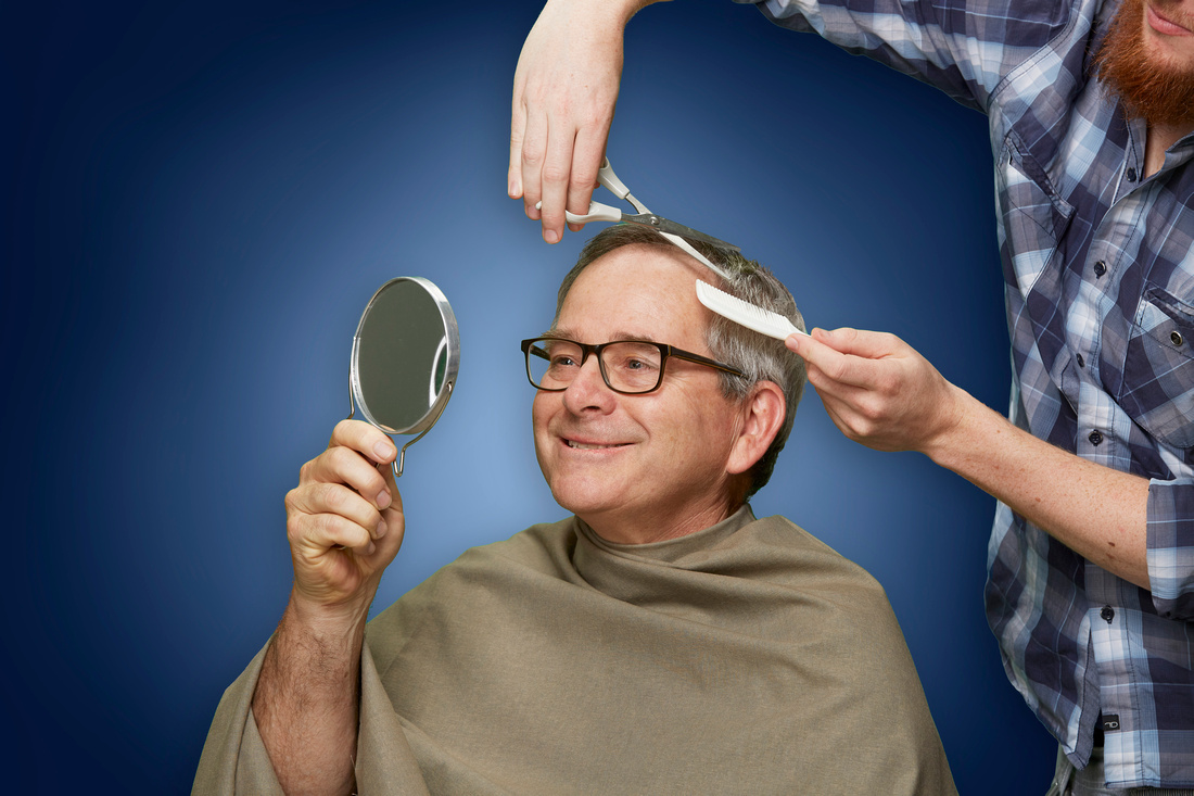 professional studio photography of Gerry McIntyre getting his hair cut in preparation for a portrait.